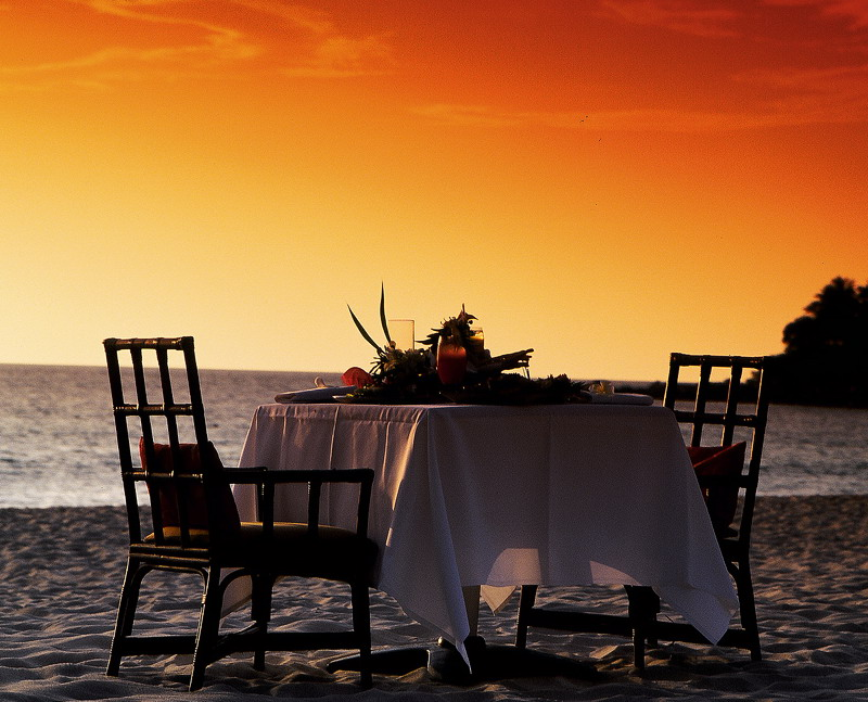 Dinner On The Beach Under An Orange Sky - 31 picturesque romantic places to draw inspiration from