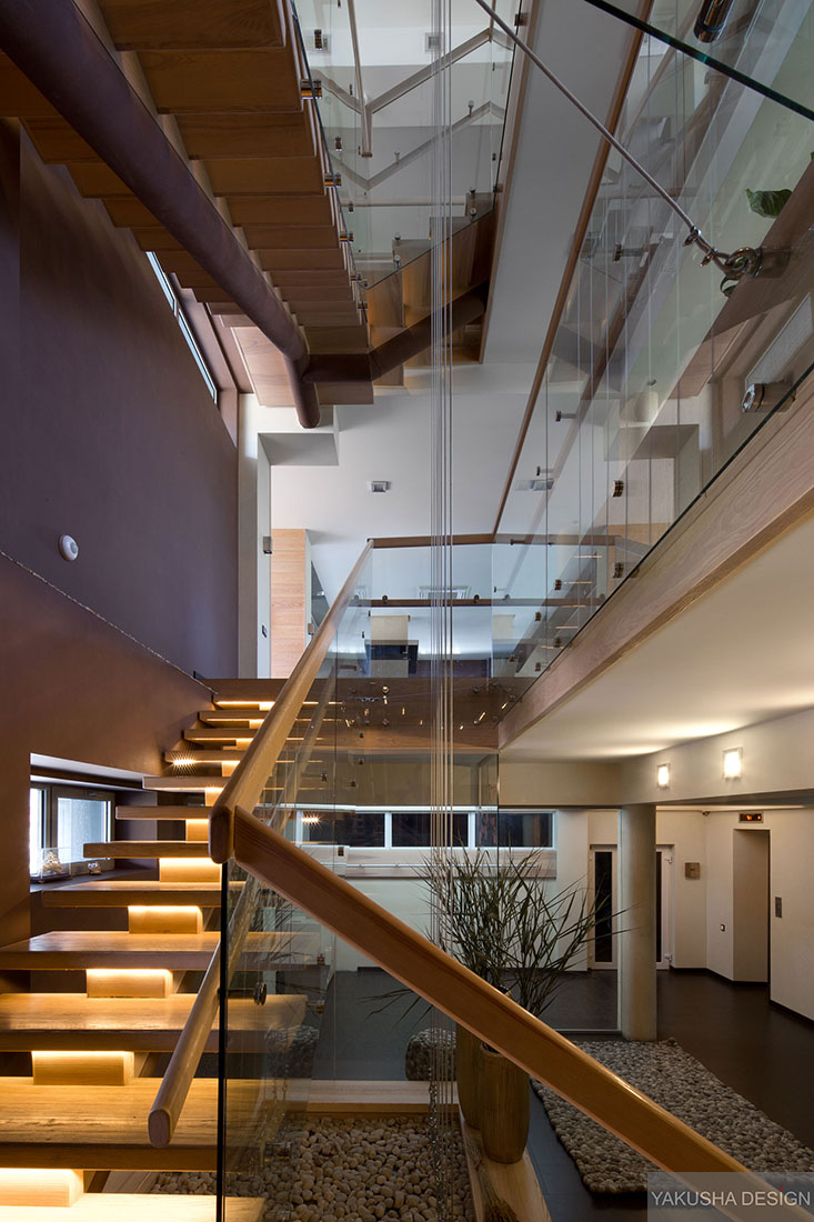 floating stairwell with pillars and glass panels over several levels