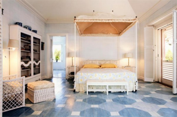 four poster bed geometric floors yellow accents
