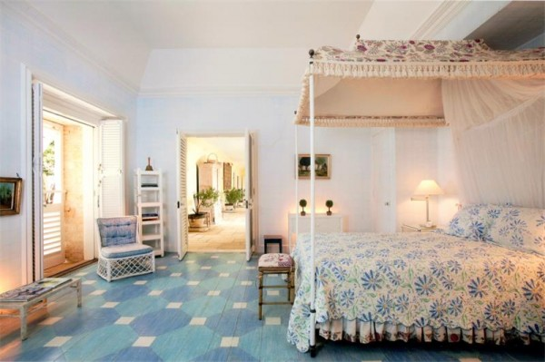four poster blue and white bed geometric floors