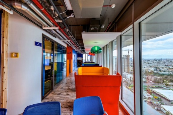 Google wouldn't be Google without its brilliant and vibrant trademark primary colors. This collaboration area boasts comfy wingbacks and other seating areas.