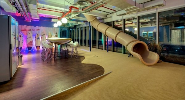 What is a Google office without a playful slide? This cafe/dining area is just one of many throughout the offices offering employees free snacks and drinks.