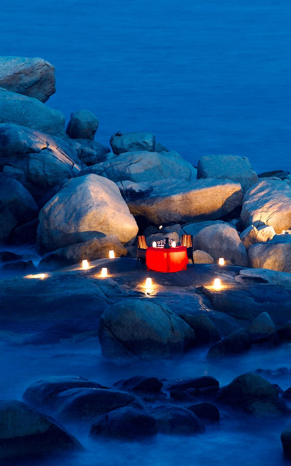 Lantern And Candle Lit Dinner On A Rocky Shore - 31 picturesque romantic places to draw inspiration from