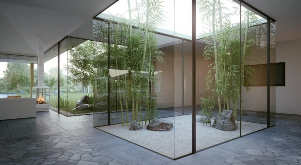 Twin glass enclosed interior courtyards bring nature indoors in the most brilliant way.