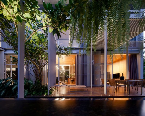 Metal slats are used as visual dividers between the interior and exterior and adjacent outdoor living spaces.