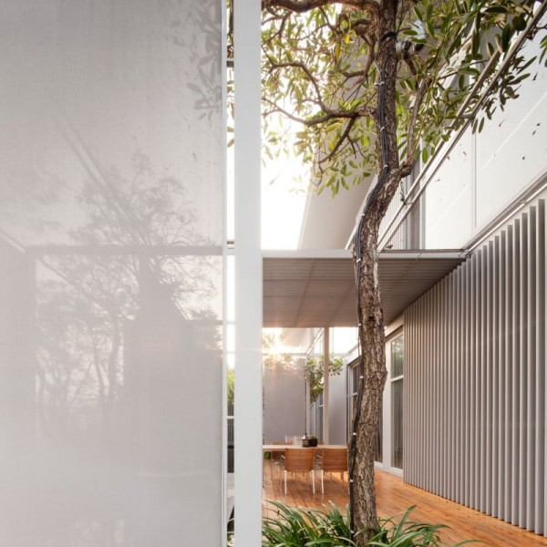 The dining area off the main interior living space boasts a beautifully finished wood floors and metal clad exterior.