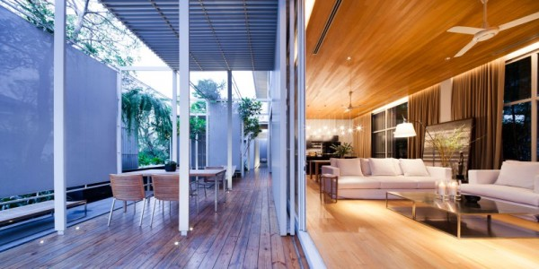 Retracting glass walls allow for boundless enjoyment from the home's interior living spaces to its exterior living spaces.