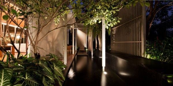 An internal sleek, brilliantly lit passageway boasts access to the home's interior spaces on every side.