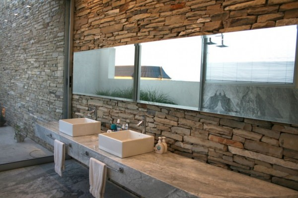 natural bathroom with twin sinks in stone
