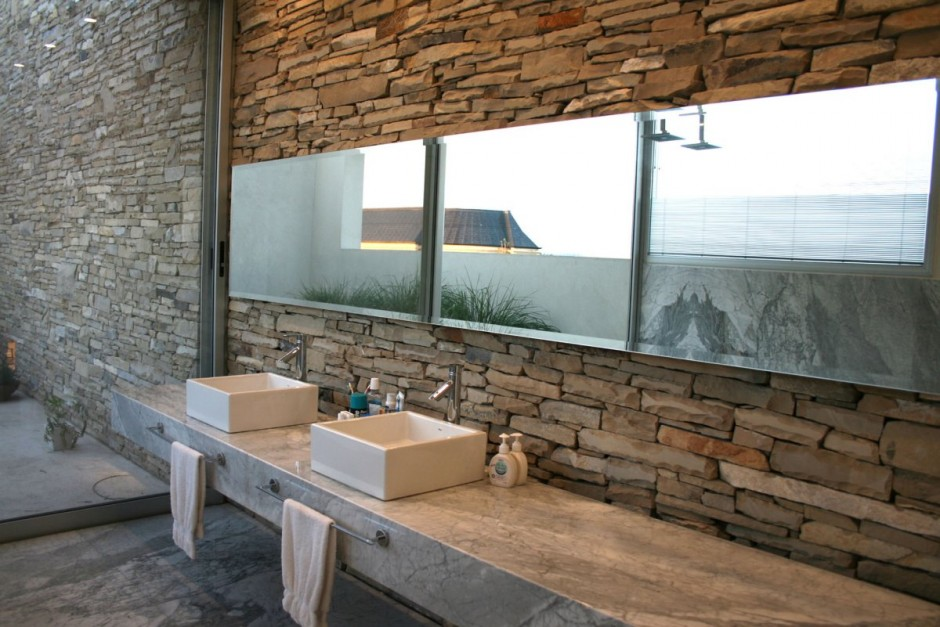 Natural bathroom with twin sinks in stone interior for Bathroom designs natural