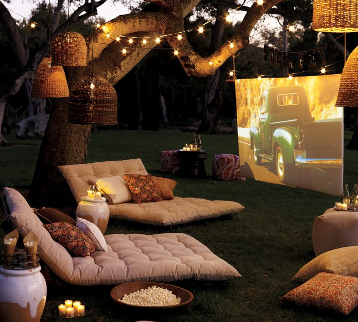 Outdoor Cinema With Soft Furishings And Tree Lighting - 31 picturesque romantic places to draw inspiration from