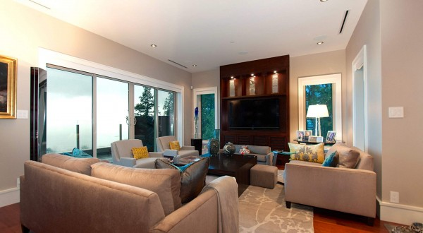 A second occasional living space has lowered ceiling for a more intimate feel.