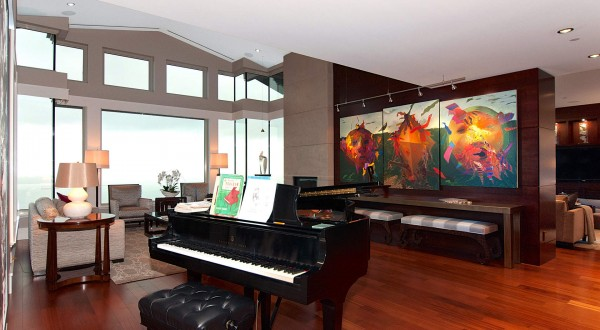 Modern art, such as the brilliantly-hued painting in the main living area, fill the penthouse.