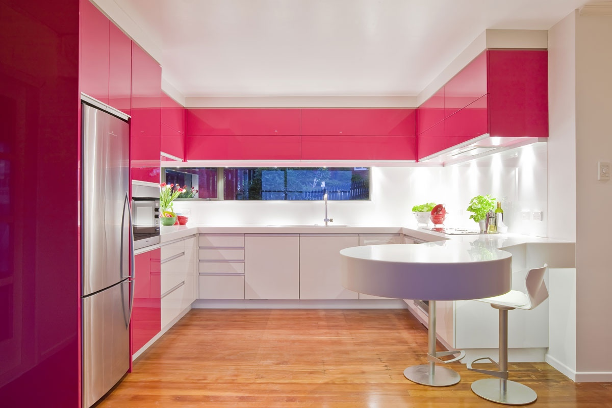 backsplash adds extra brightness to this dynamic pink modern kitchen