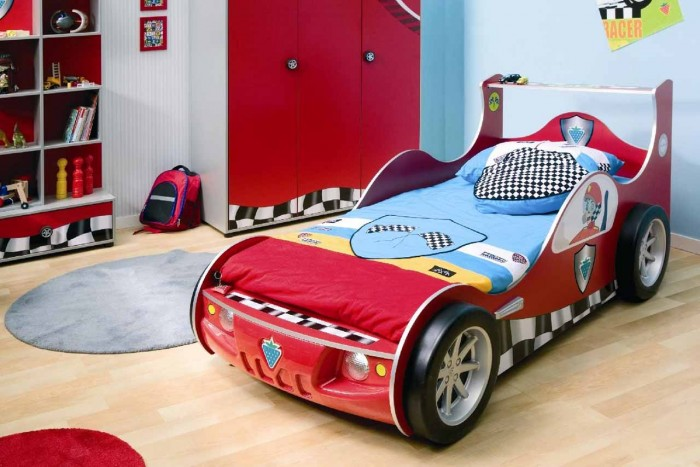 race car themed boys room in blue and red with storage