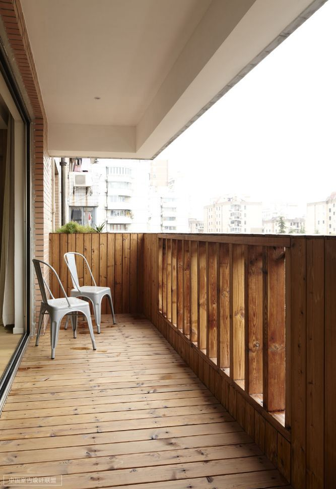 rustic wood heavy balcony with simple modern chairs
