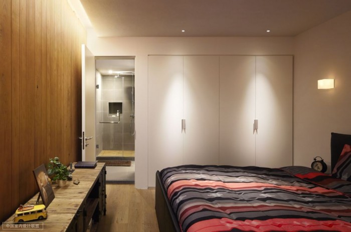 simple bedroom warm wooden cladding with en suite