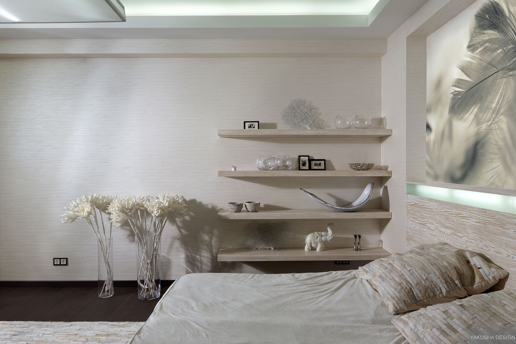 Textured white bedroom with collectables displayed on for Bookshelf behind bed