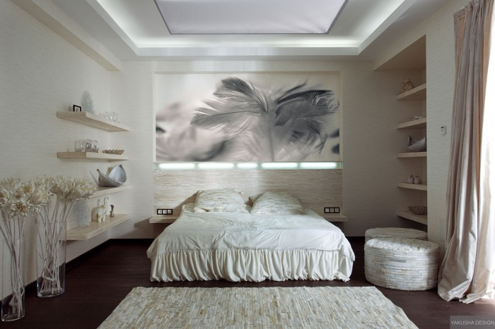 textured white bedroom with collectables displayed on shelving with feather print and textured rug