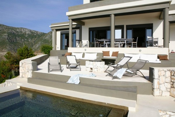 The outdoor living areas of the villa have been left intentionally bare sans decorative elements so the beauty of the surrounding seascape and wild lands could be enjoyed without distraction.