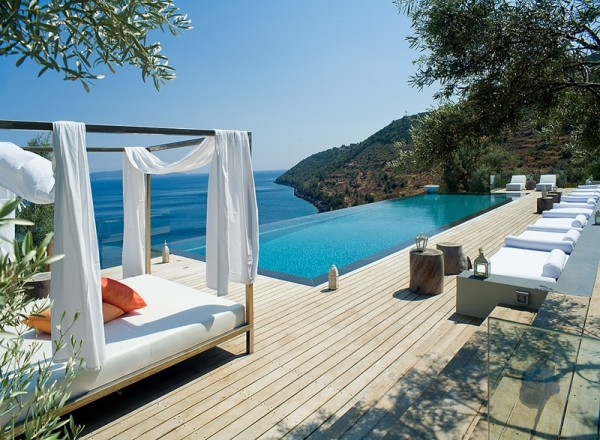 The main living area accesses an infinity pool and large lounge area with sea views.