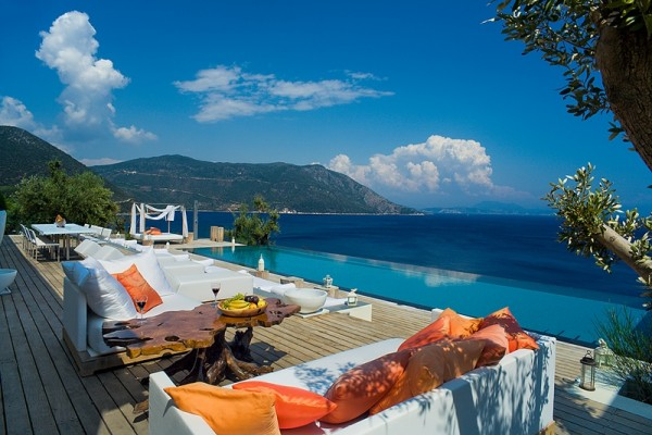 Brightly colored outdoor furnishings allow for sunbathing and lounging while taking in the beauty of the view beyond.