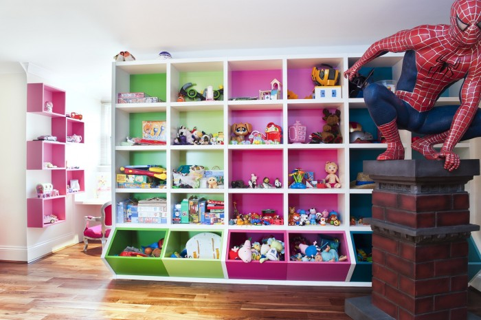 white Attic stule child'sroom with pink and green storage cubes and spiderman