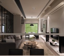 This living and dining space view shows the long hallway behind a smoky glass wall leading to the staircase beyond.
