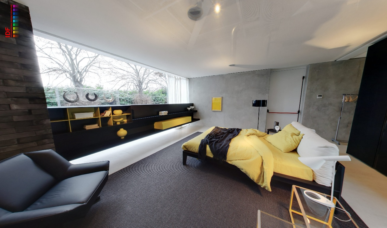 The glass house displaying furniture in natural settings for Grey and yellow bedroom