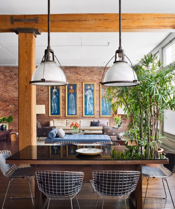 Brick Wall Studio Apartment by Stephan JAKLITSCH : GARDNER - exposed beam dining lit by industrial pendant lights with wire chairs