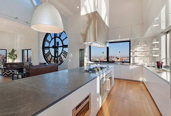 Clock Tower Apartment- open plan kitchen island in high gloss white with range