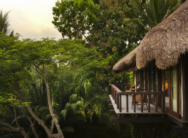 Como Shambhala Estate Bali- Guest room balcony thatched roof with views of forest