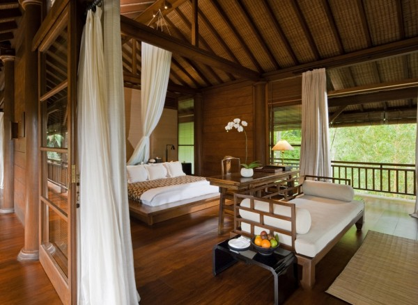 Como Shambhala Estate Bali- wooden and white pavilion style guest room with balcony