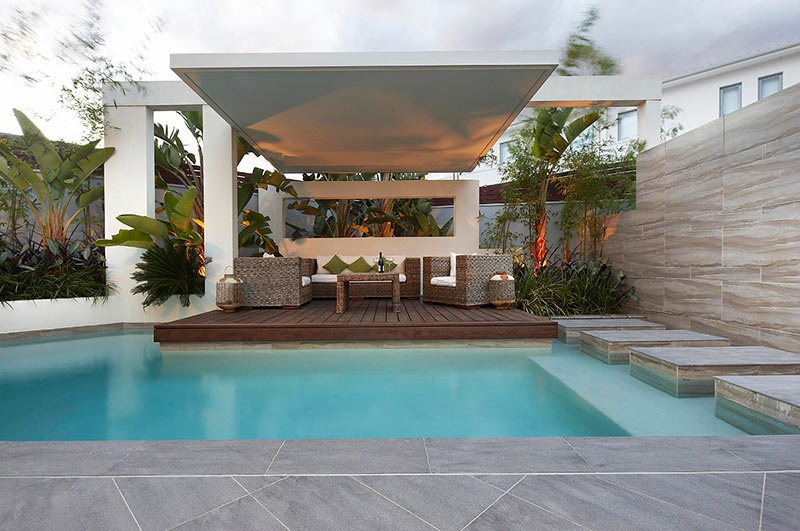Custom pool area covered outdoor lounge patio uplit with for Pool area designs