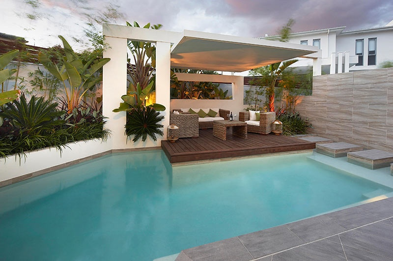 Custom pool area undercover patio lounge with garden beds for Landscape design for pool areas