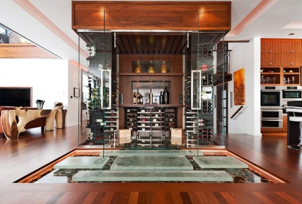 Rich wooden living with glass wine cellar and stepping stone indoor pond