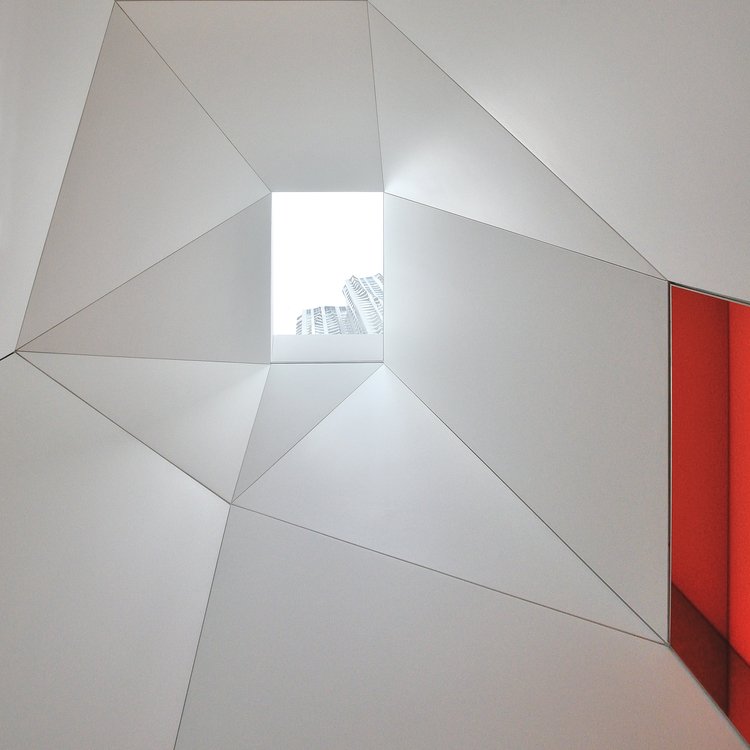 Internal Angles With View To Skylight In Red And White Interior