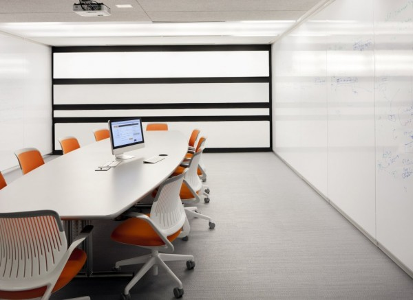 Kayak Startup Tech Office- flood lit linear conference room in white and orange