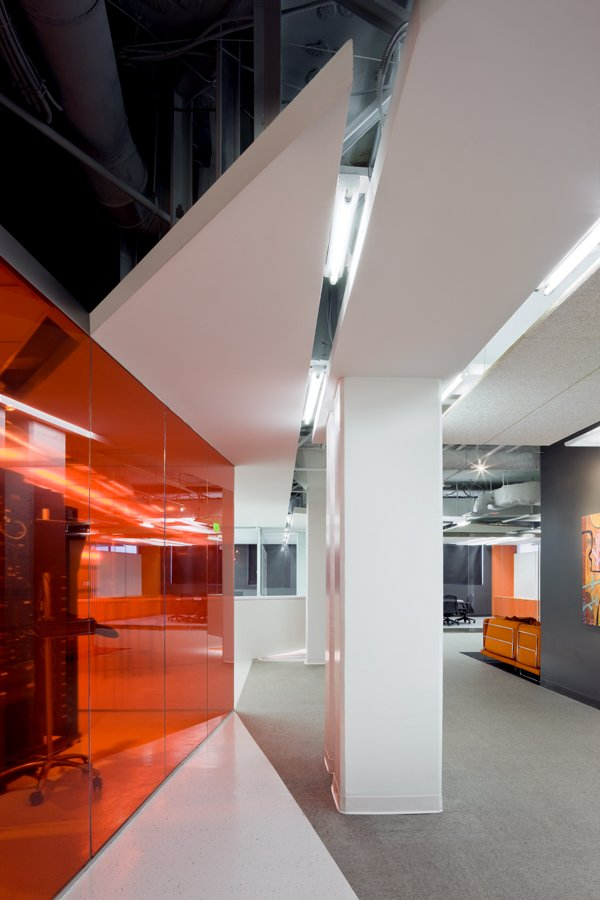 Kayak Startup Tech Office- florescent lit orange and white interior