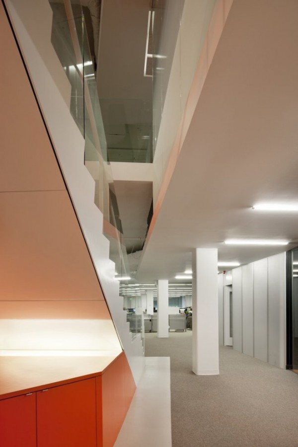 Kayak Startup Tech Office- glass panelled staircase with orange and white color scheme
