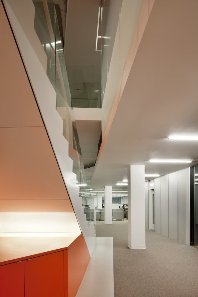 Kayak Startup Tech Office  Glass Panelled Staircase With Orange And White  Color Scheme