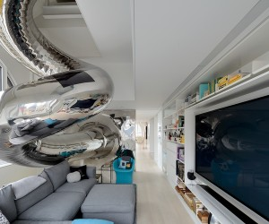 Metallic tubular slide exit into living entertainment in white and grey