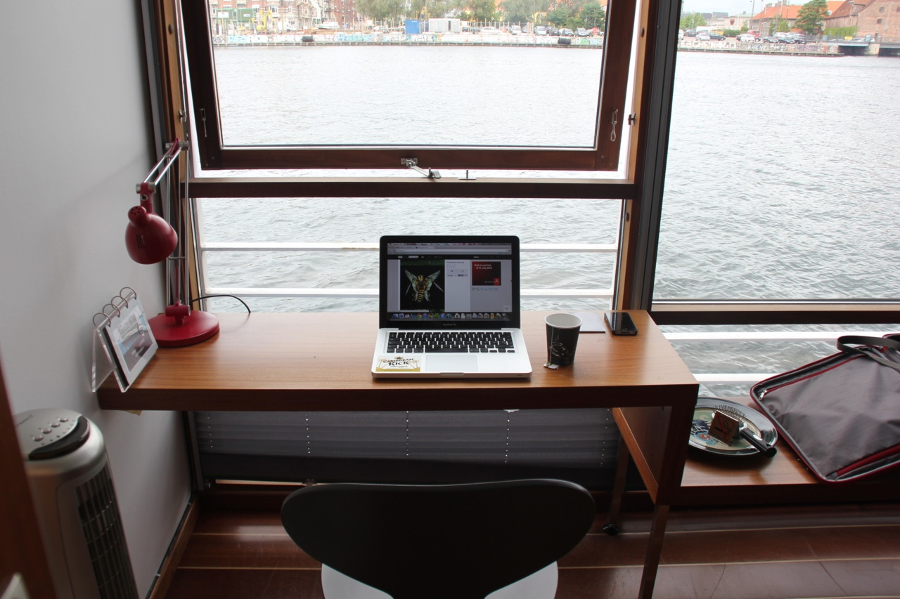 Minimal desks window set desk with views over the water for Minimalist desk