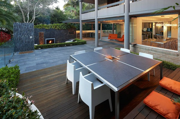 Outdoor Living with Sunken Lounge- in built dining table with wooden bench