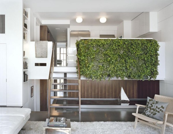Pulltab Design- White and wooden lounge with water feature and green wall