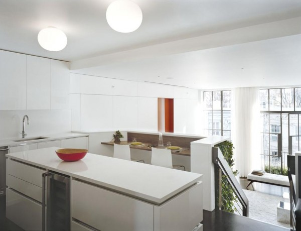 Pulltab Design- glossy white kitchen top level with view to naturally lit lounge