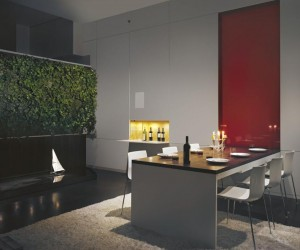 Pulltab Design- red pannelled high gloss dining area with water feature and green wall