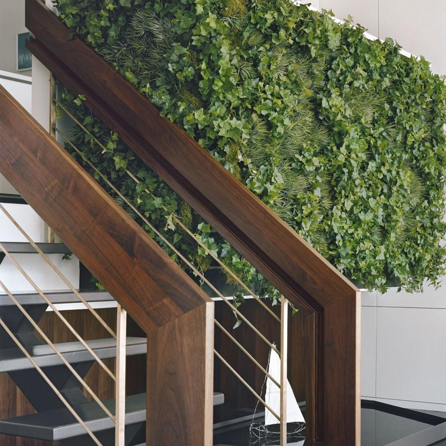 Pulltab Design wooden railing staircase and green wall with water