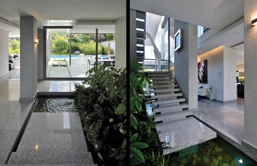 Indoor water garden at foot of floating marble staircase for Home indoor garden designs