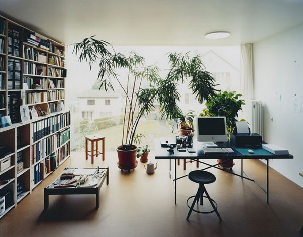 Simon Watson- glass walled workspace with private library and indoor plant